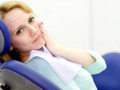 Что делать, если болит зуб под коронкой