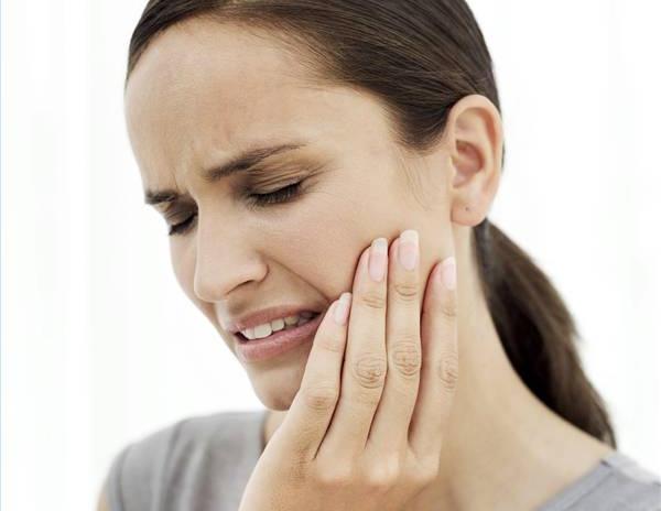 Болезненные ощущения в зубе